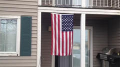Landlords tell residents to take down American flag